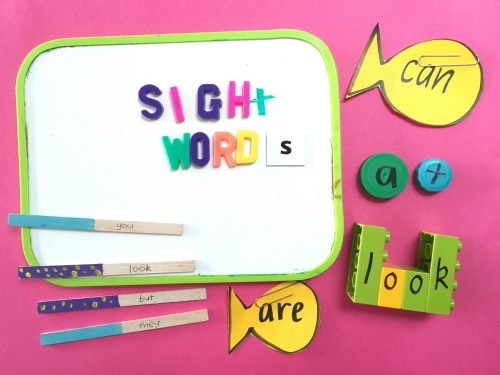 A whiteboard with magnetic letters that read SIGHT WORDS