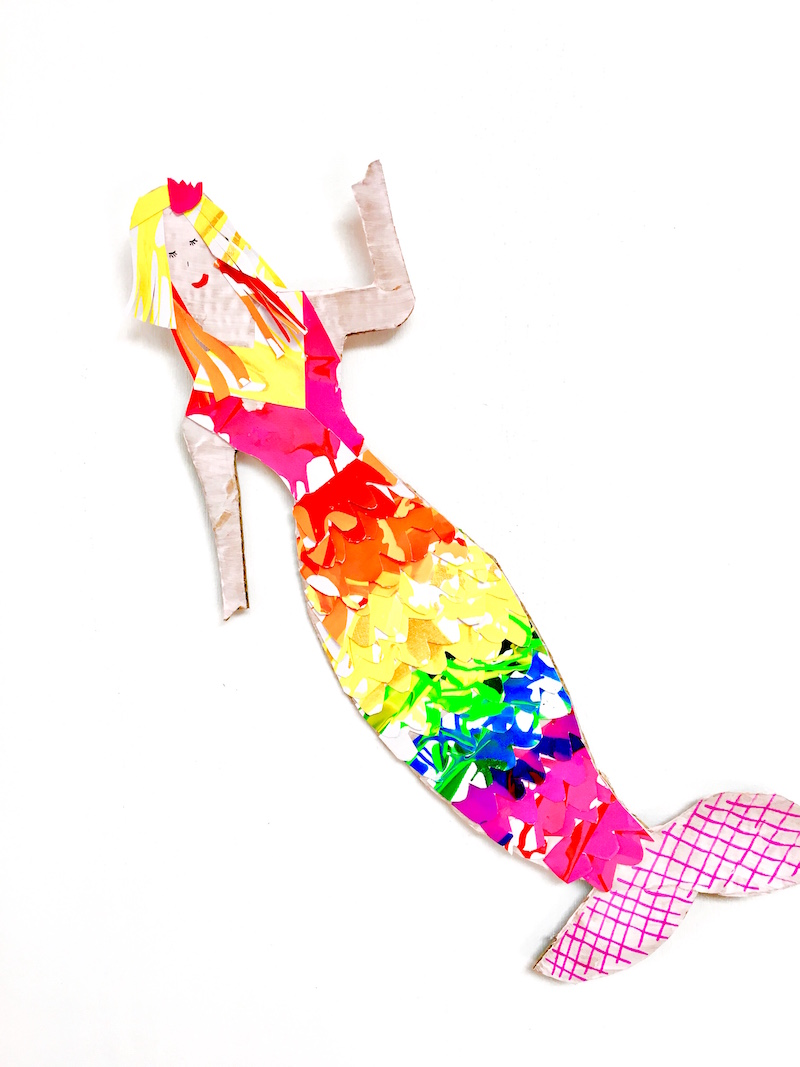 A colourful mermaid made out of cardboard and salad spinner art