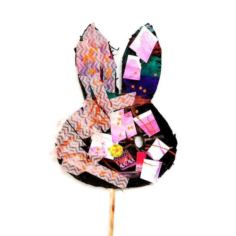 A child made bunny mask with collage
