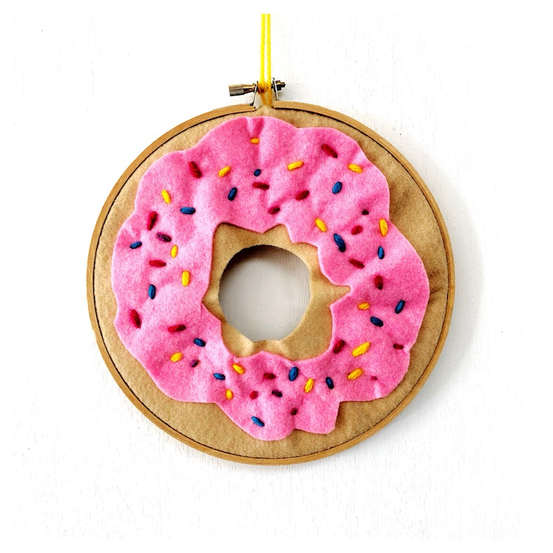 Do you have a little one super keen to tackle sewing? This donut wall hanging is just one of 30+ simple sewing projects for kids that have been a part of Sew a Softie month. #sewing #sewingforkids #kidsactivities