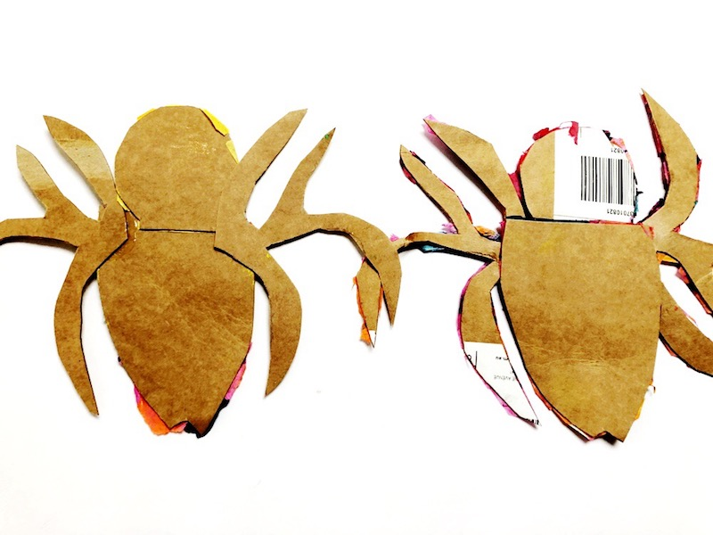 2 cardboard templates of spiders for a project inspired by the Very Busy Spider by Eric Carle