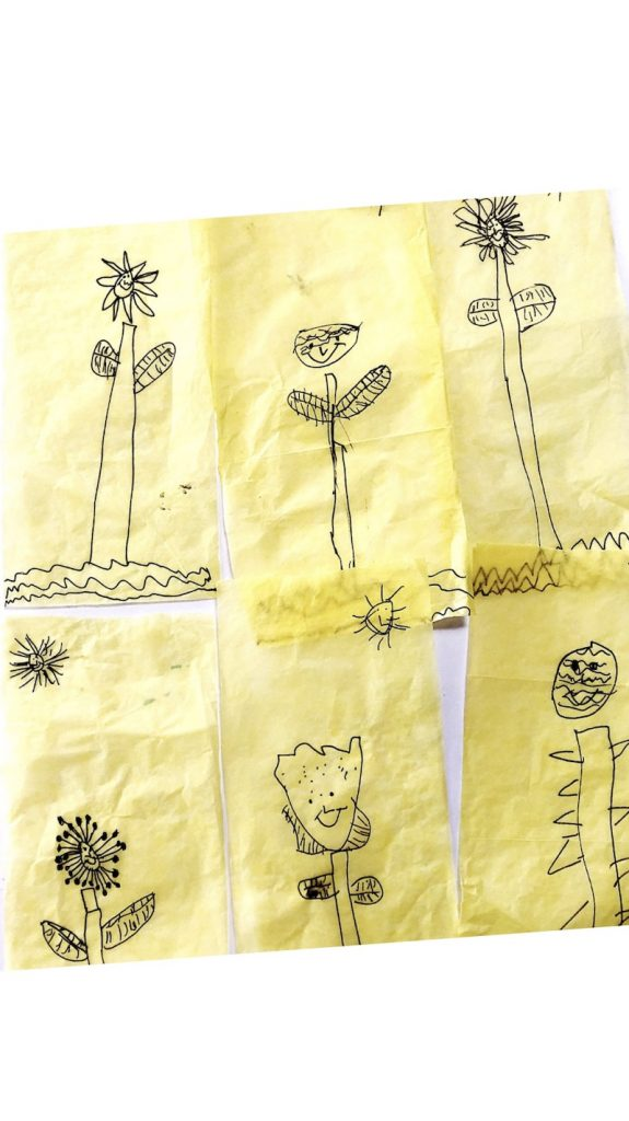 6 child's drawings of flowers for a Spring flower art project.