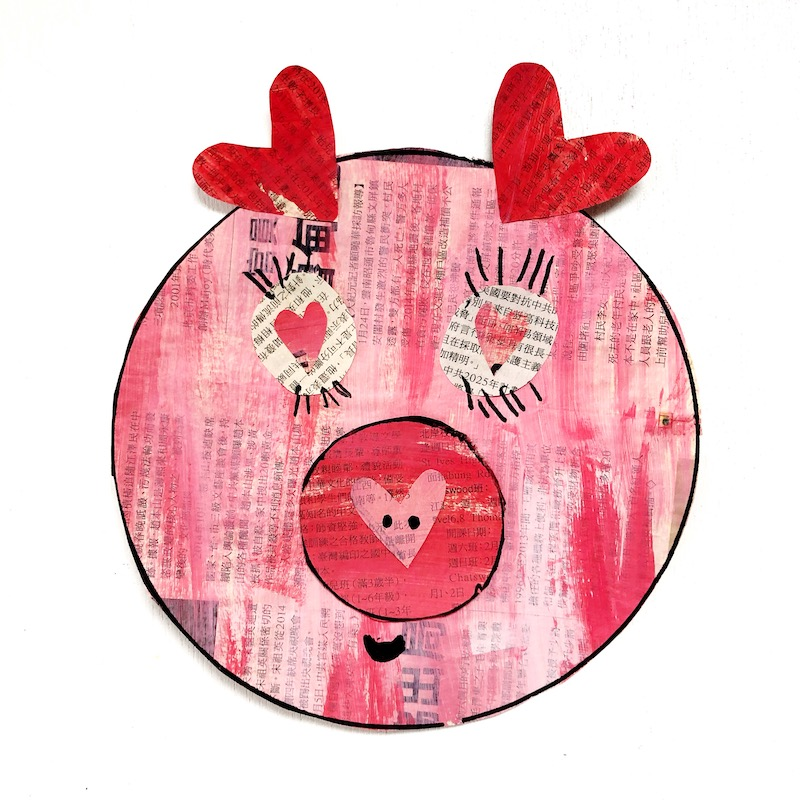 A children's craft project featuring a painted newspaper pig for Chinese New Year